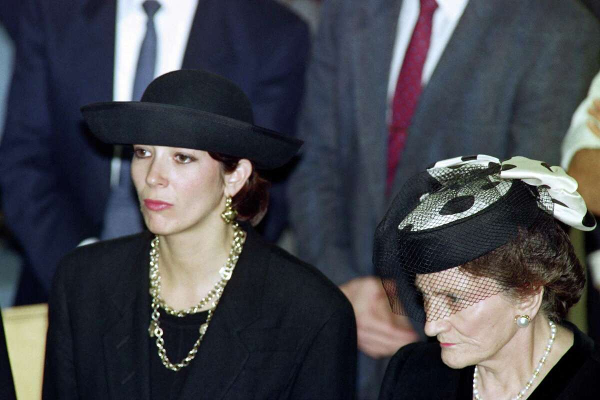 (FILES) In this file photo taken on November 10, 1991 British press magnat Robert Maxwell's daughter Ghislaine (L) and wife Elisabeth (R) attend the funeral serice for burial on the Mount of Olives of their father and husband - British socialite Ghislaine Maxwell carries the heavy heritage of a family dominated by the unusual personality of her father, Robert, drowned at sea in mysterious circumstances leaving behind a resounding financial scandal and the fall of his press empire. Accused of having procured very young girls, some minors, to her friend the financier Jeffrey Epstein, Ghislaine, 58, takes up the sad tradition of headlines around a family which fueled the chronicle in the 90s. (Photo by Sven NACKSTRAND / AFP) (Photo by SVEN NACKSTRAND/AFP via Getty Images)
