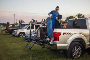 """Families arrive to watch a drive-in showing of """"The Princess Bride"""" as part of the Midland Area Community Foundation's Riverdays festival Friday, July 31, 2020 at Midland County Fairgrounds. (Katy Kildee/kkildee@mdn.net)"""