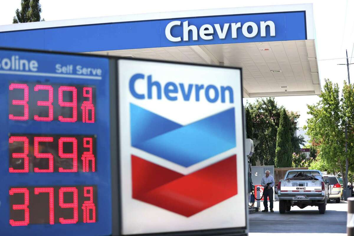 A customer pumps gas into his truck at a Chevron gas station on July 31, 2020 in Novato, California.