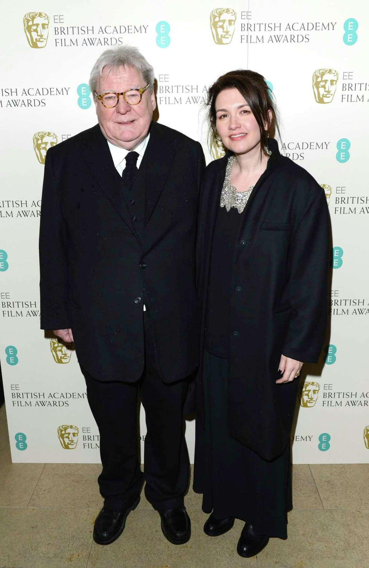 FILE - Director Alan Parker and his wife, Lisa arrive for the BAFTA Film Awards in London on Feb. 10, 2013. Parker, whose movies included a€œBugsy Malone,a€ a€œMidnight Expressa€ and a€œEvita,a€ has died at the age of 76. A statement from the directora€™s family says Parker died Friday in London after a long illness. (Photo by Jon Furniss/Invision/AP, File)