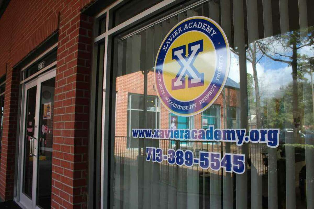 At Xavier Academy, a K-12 center, there are two instruction rooms with students who circle around tables and complete their work, an elementary instruction room, an art room, a room for the school's licensed family therapist and an open space with tables where electives are taught.