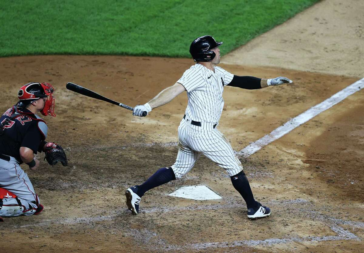 NEW YORK, NEW YORK - JULY 31: Brett Gardner #11 of the New York Yankees hits a two run eighth inning home run against the Boston Red Sox during their home opener at Yankee Stadium on July 31, 2020 in New York City. The 2020 season had been postponed since March due to the COVID-19 pandemic. (Photo by Al Bello/Getty Images)