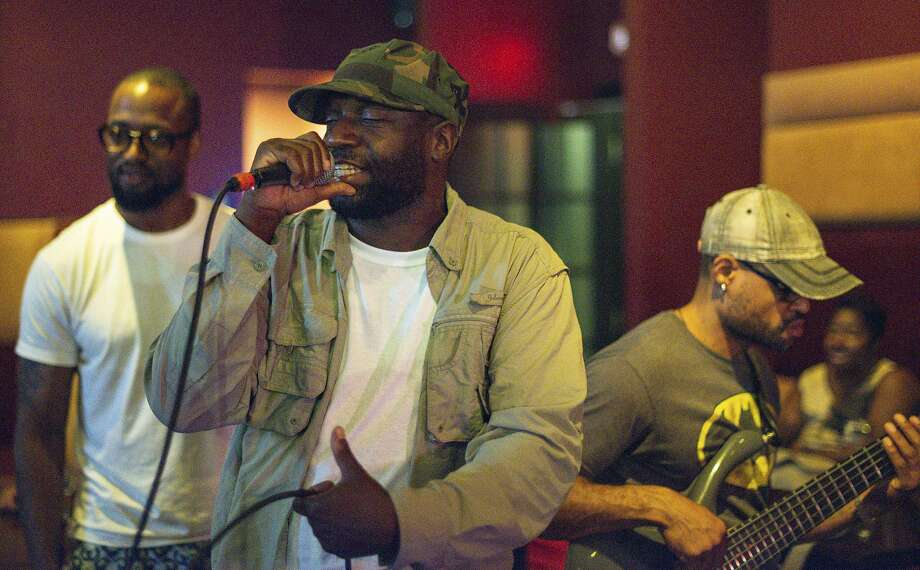 """Malik B. performs in Philadelphia, where he was born. The rapper was an early member of the hip-hop group the Roots, appearing on four of their albums, including """"Things Fall Apart,"""" which won a Grammy in 2000, about the time he departed the group. Photo: James Johnson / Associated Press"""