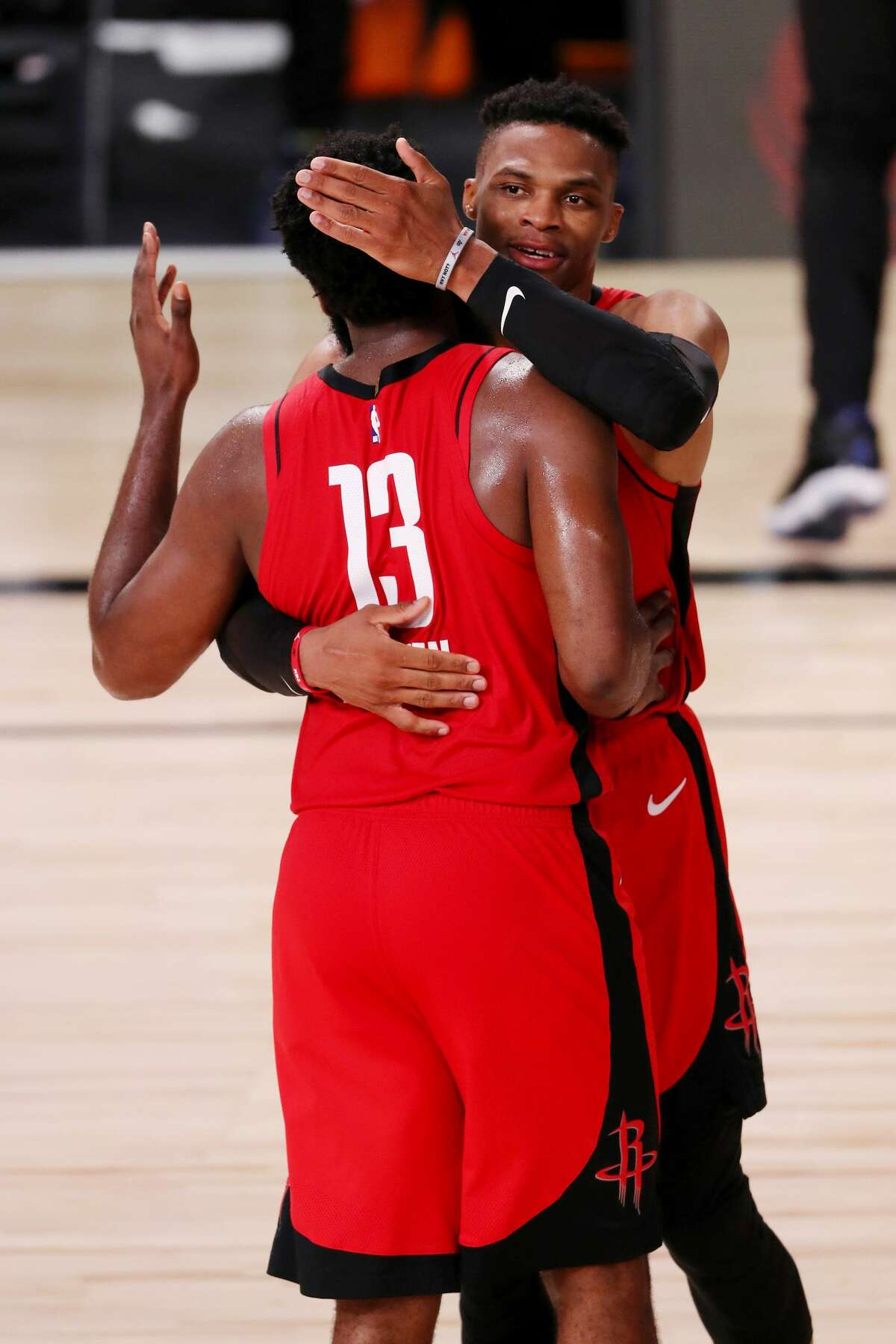 LAKE BUENA VISTA, FLORIDA - JULY 31: Russell Westbrook #0 of the Houston Rockets celebrates with James Harden #13 after defeating the Dallas Mavericks 153-149 during overtime at The Arena at ESPN Wide World Of Sports Complex on July 31, 2020 in Lake Buena Vista, Florida. NOTE TO USER: User expressly acknowledges and agrees that, by downloading and or using this photograph, User is consenting to the terms and conditions of the Getty Images License Agreement. (Photo by Mike Ehrmann/Getty Images)