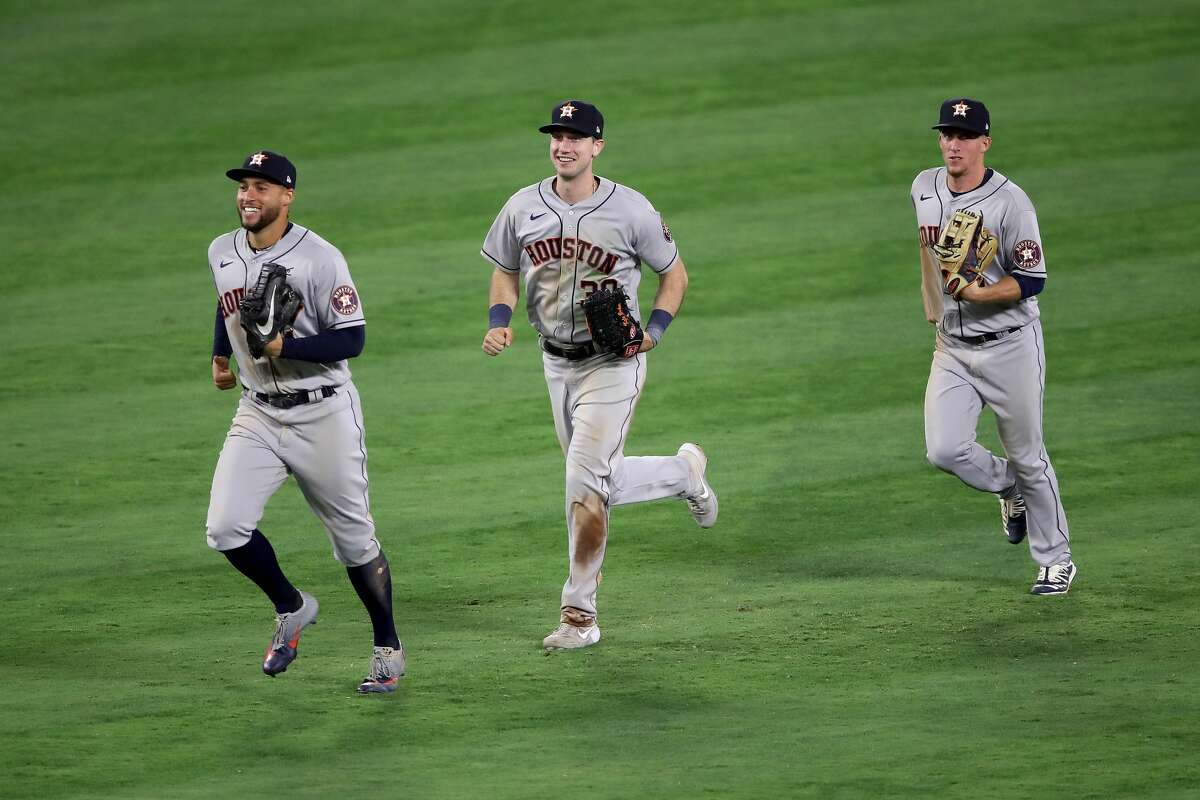 ANAHEIM, CALIFORNIA - JULY 31: Kyle Tucker #30, George Springer #4 and Myles Straw #3 of the Houston Astros celebrate after defeating the Los Angeles Angels 9-6 in a game at Angel Stadium of Anaheim on July 31, 2020 in Anaheim, California. (Photo by Sean M. Haffey/Getty Images)