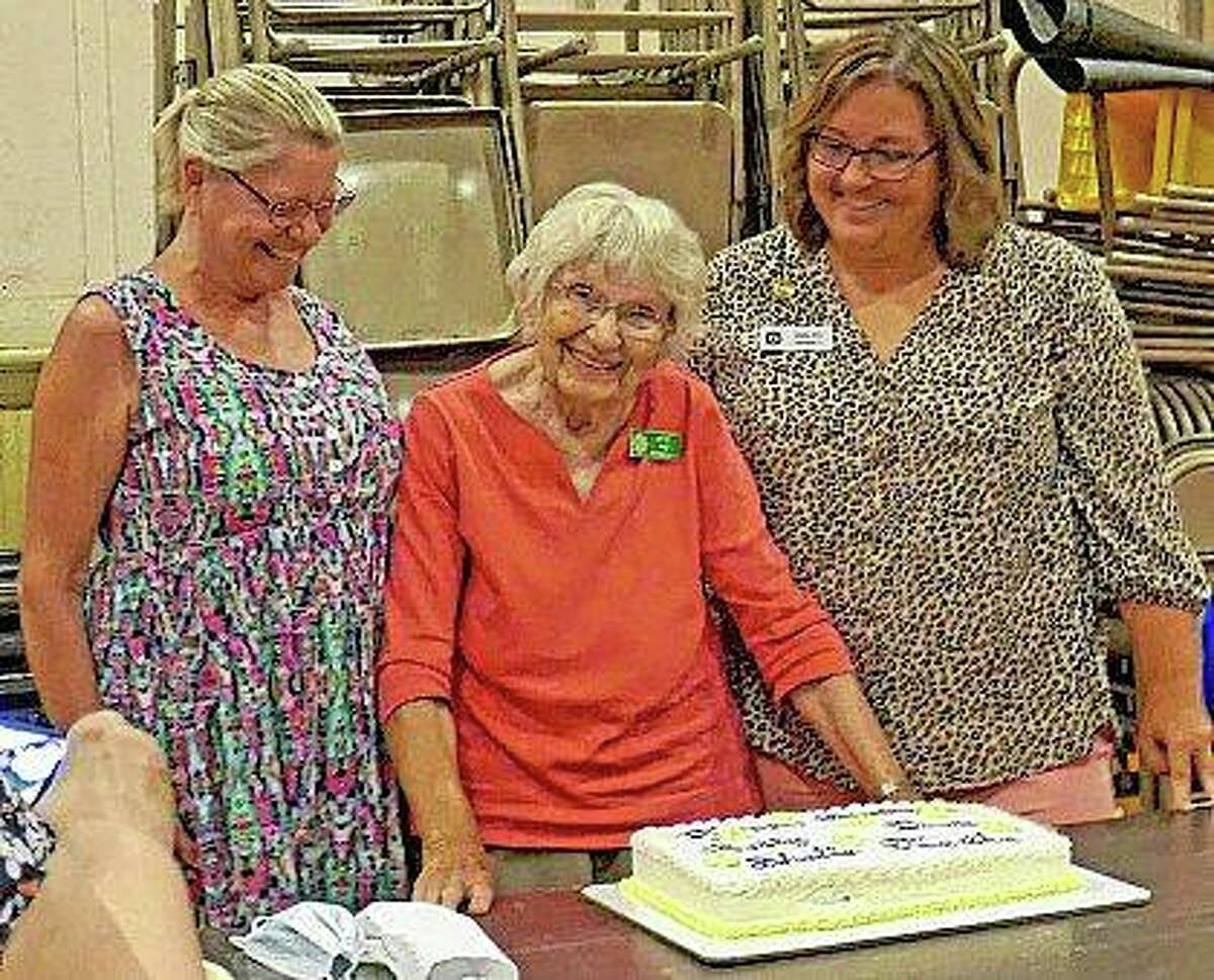 """Betty Pine (center) celebrates her 89th birthday during Wednesday's Pilot Club of Jacksonville meeting. The club, which had not had an in-person meeting since February, used the gathering as a chance to celebrate birthdays they had missed since then. Pine, who club members say is a """"firecracker,"""" turned 89 on July 4. Club members Diane Farmer (left) and Shelle Allen also celebrated birthdays in July."""