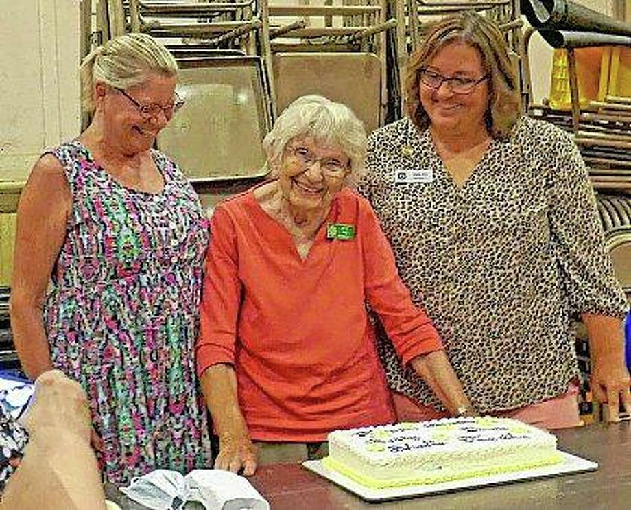 "Betty Pine (center) celebrates her 89th birthday during Wednesday's Pilot Club of Jacksonville meeting. The club, which had not had an in-person meeting since February, used the gathering as a chance to celebrate birthdays they had missed since then. Pine, who club members say is a ""firecracker,"" turned 89 on July 4. Club members Diane Farmer (left) and Shelle Allen also celebrated birthdays in July. Photo: Photo Provided"