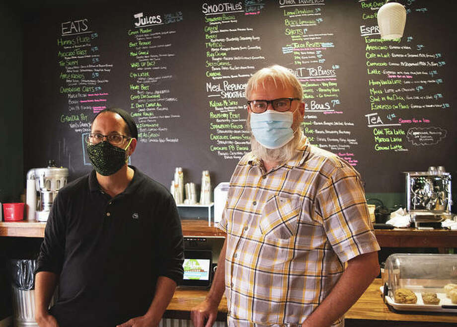 Owner Jeff Newman and coffee roaster Richard Dunseth have transitioned The Fresh Press into Elm City Roastery in Jacksonville. Photo: Rochelle Eiselt | Journal-Courier