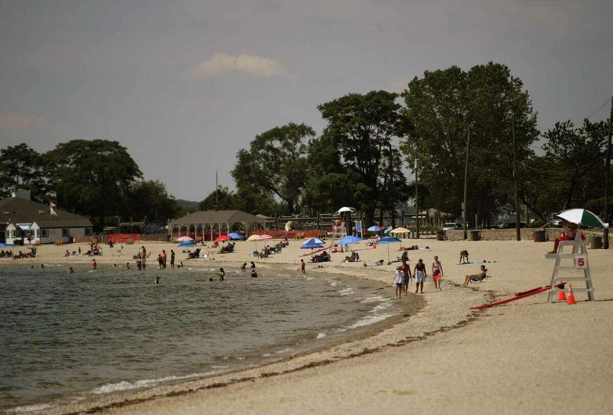 Beachgoers beat the heat at Compo Beach in Norwalk, Conn. on Monday, July 20, 2020.