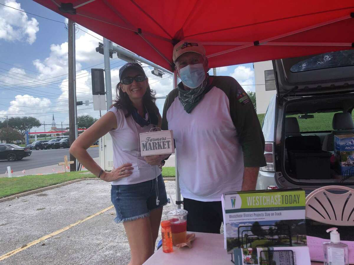 Westchase District Farmers Market manager John Carey (right) and volunteer Blair Johnson (left)