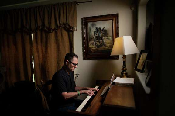 Henry Darragh, 44, plays his piano at his home on Friday, July 31, 2020, in Houston. Darragh is a versatile musician and composer who lately has found himself in a reflective mode as COVID-19 decimated the live music industry.