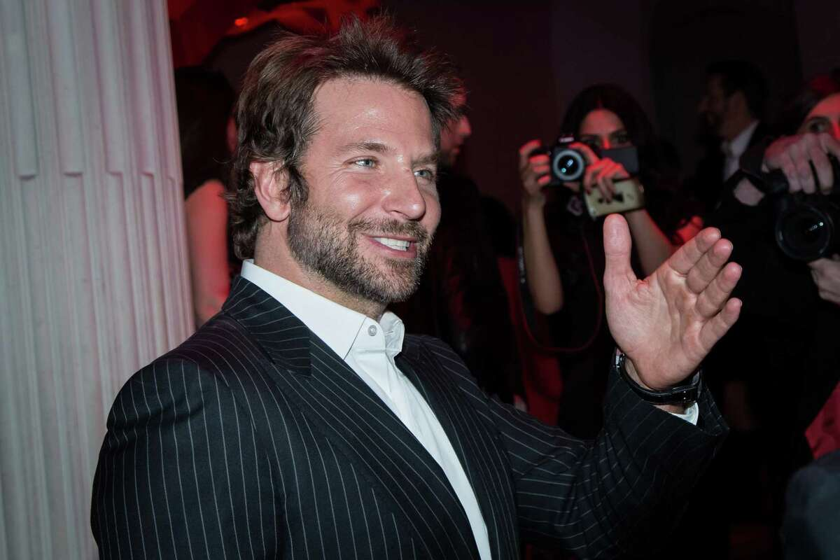 Actor Bradley Cooper poses for photographers upon arrival at the L'Oreal Red Obsession Party in Paris, Tuesday, March 8, 2016.
