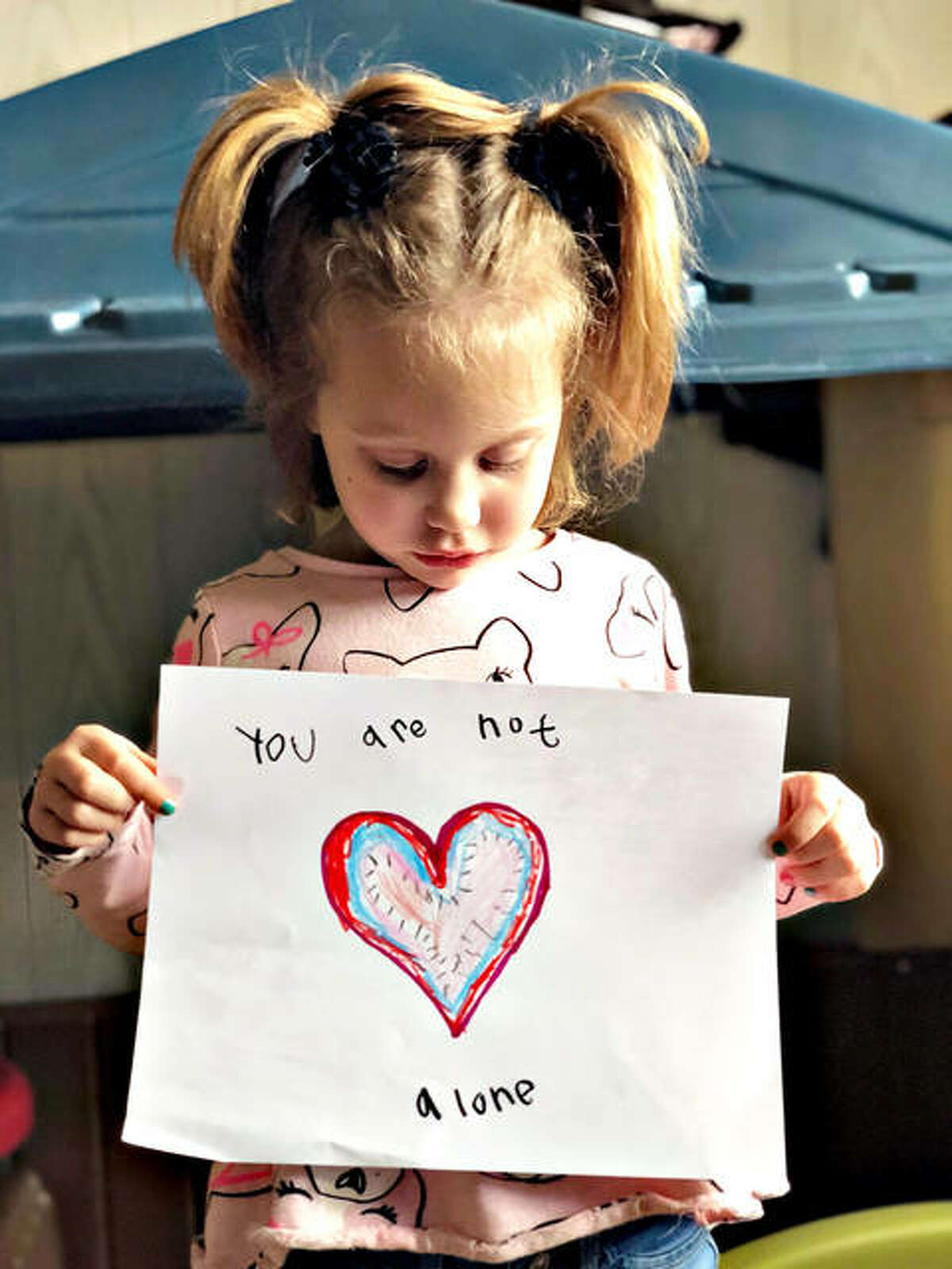 Matilda Kassel poses with one her heartfelt replies. She contines creating art and sending messages of positivity to people who need cheering up.