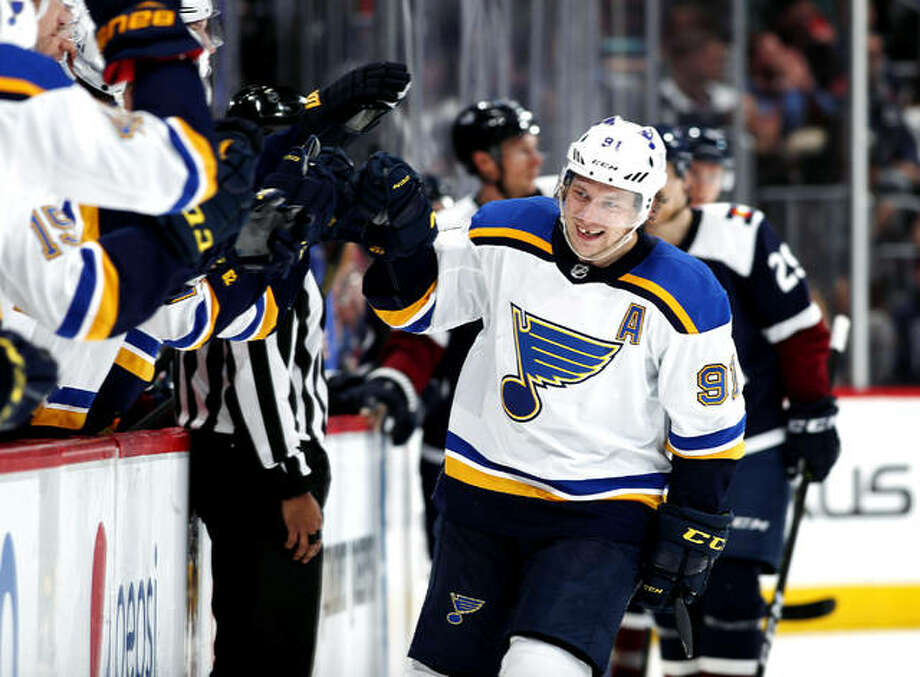 Blues right wing Vladimir Tarasenko, right, is congratulated as he passes the team box after scoring a goal against the Colorado Avalanche during the third period of an 2019 game in Denver. Tarasenko makes his return Sunday after early season shoulder surgery that limited him to three goals in 10 games. Photo: AP Photo
