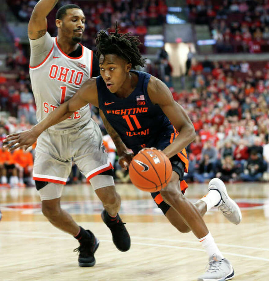 Illinois' Ayo Dosunmu (right) drives against Ohio State's Luther Muhammad March 5 in Columbus, Ohio. Dosunmu has announced that he is withdrawing from the NBA Draft and will return to the Illini next season.