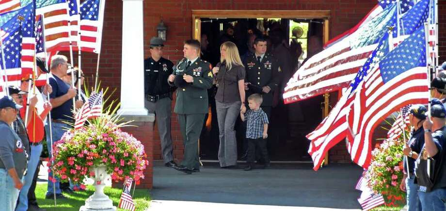 Family and friends pay their final respects to Staff Sgt. Derek Farley at the W.J. Lyons Jr. Funeral Home in Rensselaer on Thursday, August 26, 2010.  Honor guard outside the funeral home are members of the Patriot Guard Riders.  (John Carl D'Annibale / Times Union) Photo: John Carl D'Annibale / 00010012A