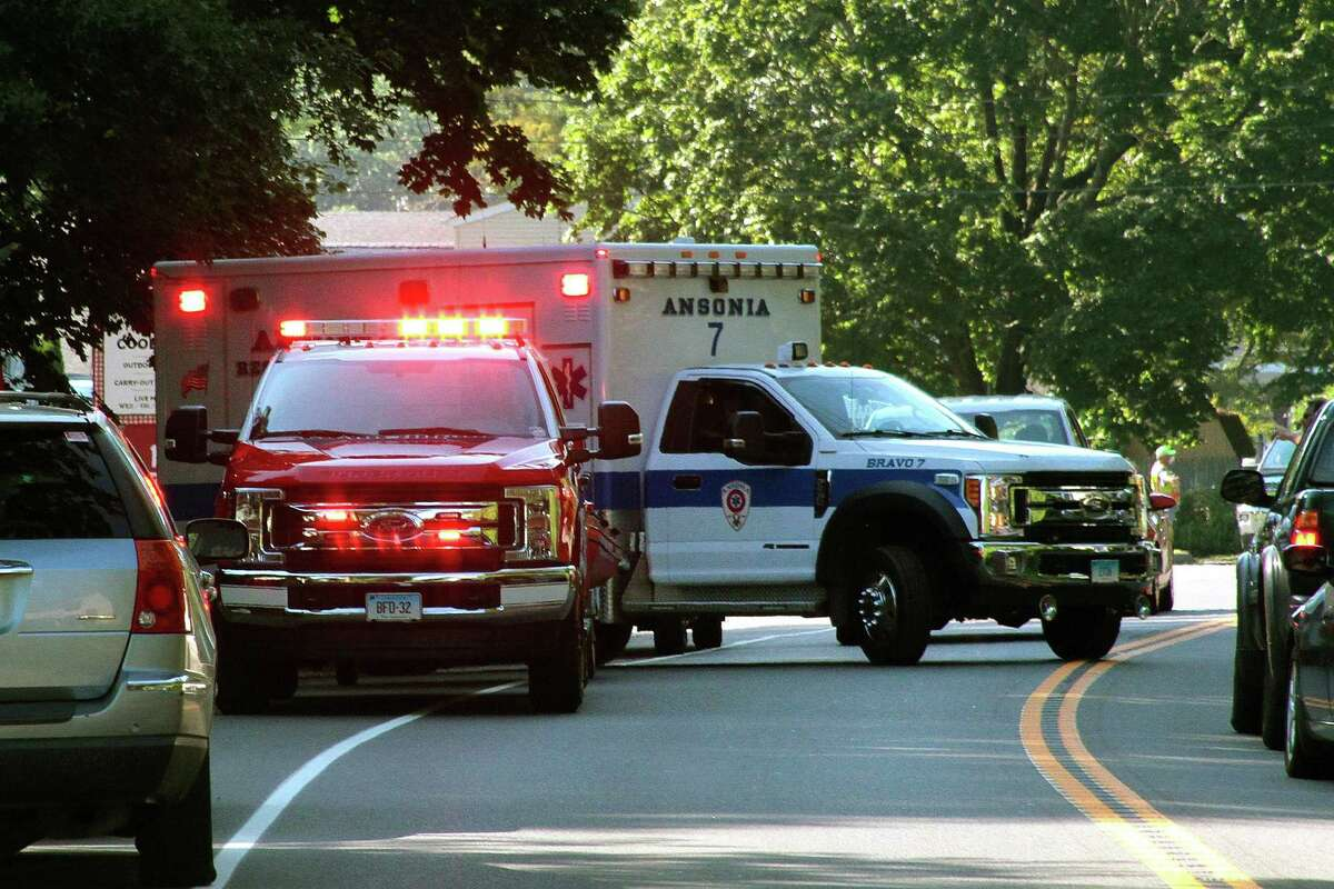 An Ansonia ambulance leaves the scene where a vehicle landed in the Housatonic River in Seymour, Conn., on Friday July 31, 2020. First responders rushed to the area of 179 Roosevelt Drive (Route 34) shortly before 4 p.m. after a crash on the side of the road catapulted a vehicle into the Housatonic River, according to initial dispatch reports.