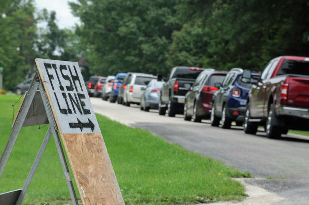 Signs posted throughout Dorchester directed the long line of vehicles to the fish fry drive-through service. Although the community's annual homecoming was canceled this year, the Dorchester Volunteer Fire Department opted to continue its annual fish fry as a drive-through service.