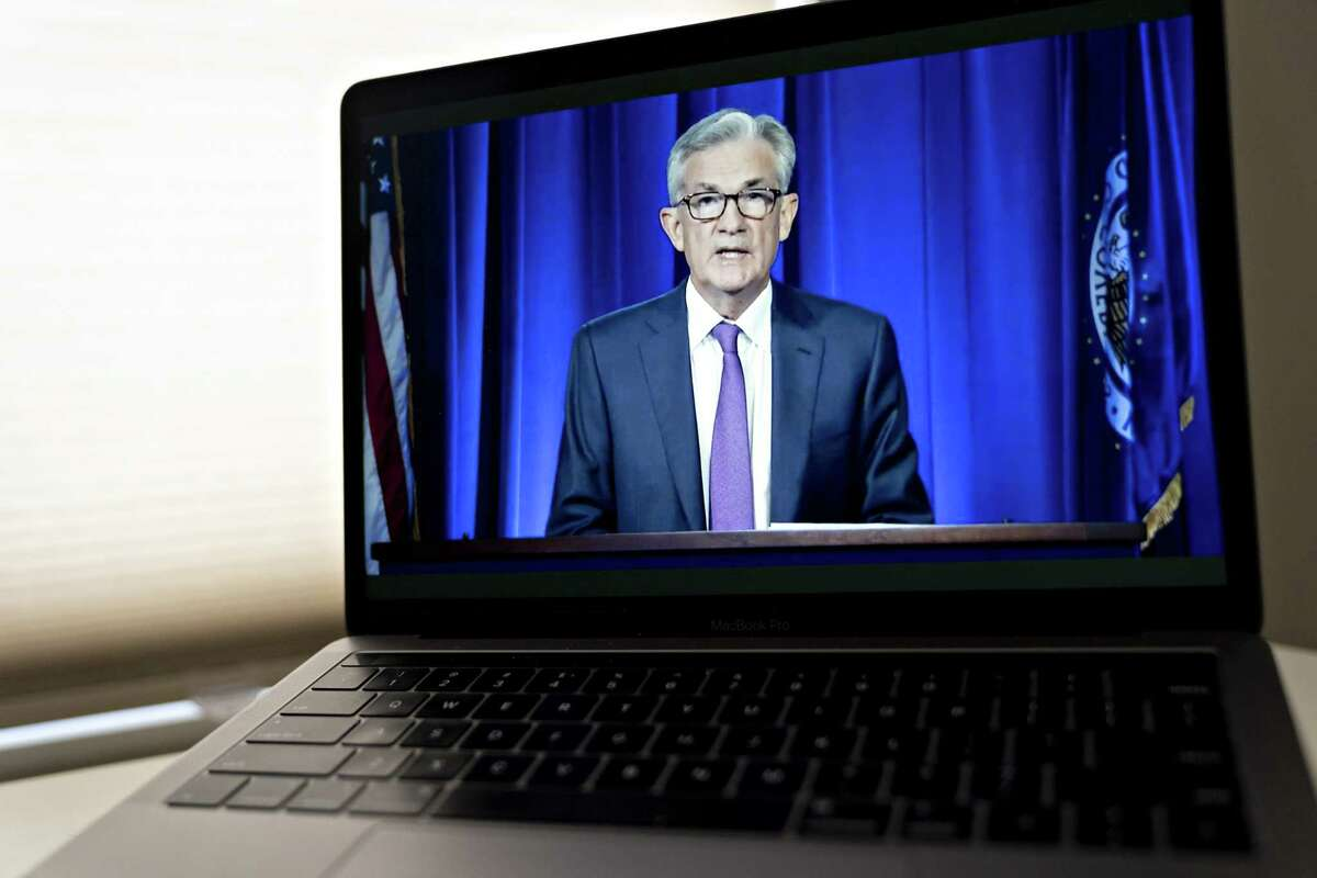 Jerome Powell, chairman of the U.S. Federal Reserve, speaks during a virtual news conference seen on a laptop computer in Arlington, Virginia, U.S., on Wednesday, July 29, 2020. Federal Reserve officials left their benchmark interest rate unchanged near zero and again vowed to use all their tools to support the U.S. economy amid a shaky recovery from the coronavirus pandemic. Photographer: Andrew Harrer/Bloomberg