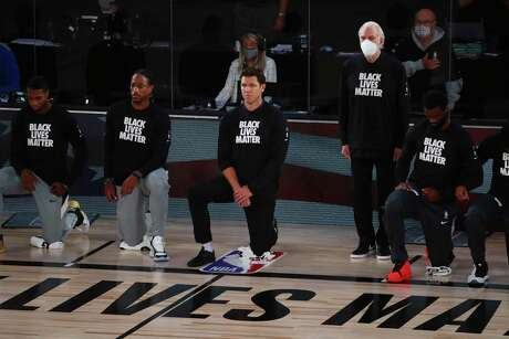 Gregg Popovich has been one of the league's most outspoken coaches against racism, but the former Air Force officer stood for the anthem in Friday's restart opener.