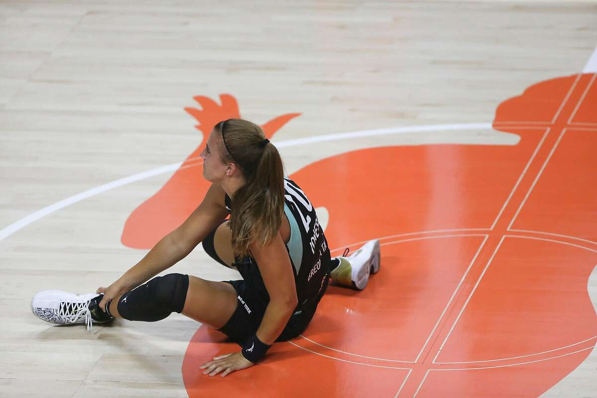 Sabrina Ionescu hurts her left ankle in the second quarter against Atlanta on July 31.