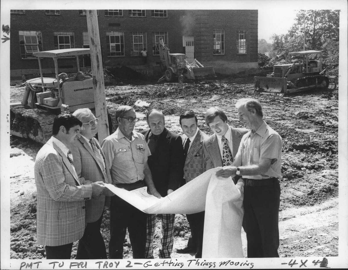 Watervliet New YorkHigh School. Workers begin construction of addition. Left to right: George A Perry, Superintendent of Schools; Eugene J Donlon, School Business Administrator; James D Hayes, School Board President; John C Weaver, High School Principal; Henry J Ashline, Board Member; Edward Reinfort, Board Member; and Weslye B Thompson, Construction Manager. August 2, 1974 (Paul D. Kniskern Sr./Times Union Archive)