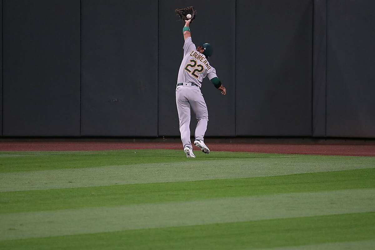 SEATTLE, WASHINGTON - JULY 31: Ramon Laureano #22 of the Oakland Athletics catches a fly out in the eighth inning against the Seattle Mariners during their Opening Day game at T-Mobile Park on July 31, 2020 in Seattle, Washington. (Photo by Abbie Parr/Getty Images)