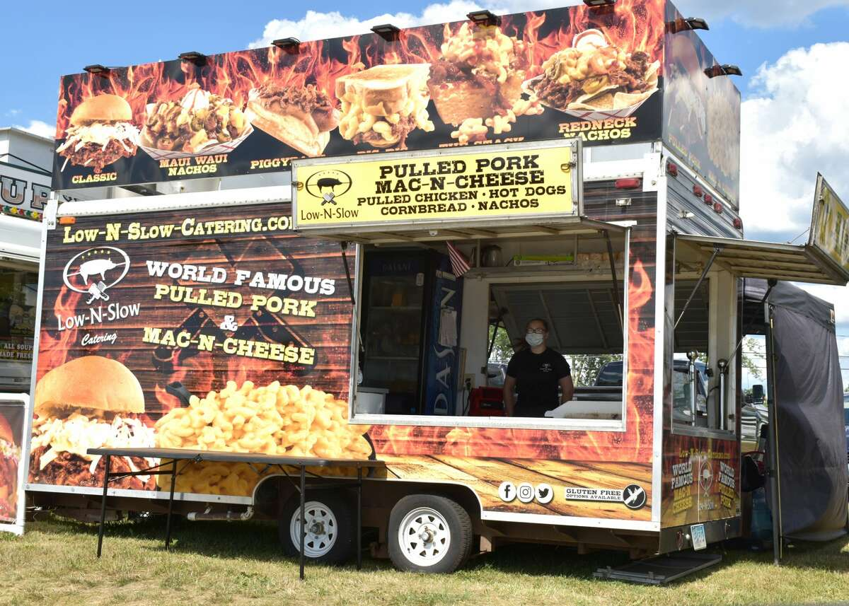 Tailgaters, families, and friends, gathered, socially distanced, at the Goshen Fairgrounds for a Food Truck Drive-thru event to support St. Maron Church and Brooker Memorial, on Saturday, August 1, 2020
