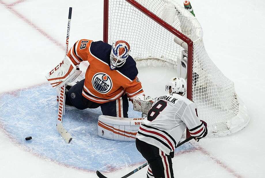 Edmonton goalie Mikko Koskinen stops a shot by Chicago's Dominik Kubalik, who had two goals. Photo: Jason Franson / Associated Press
