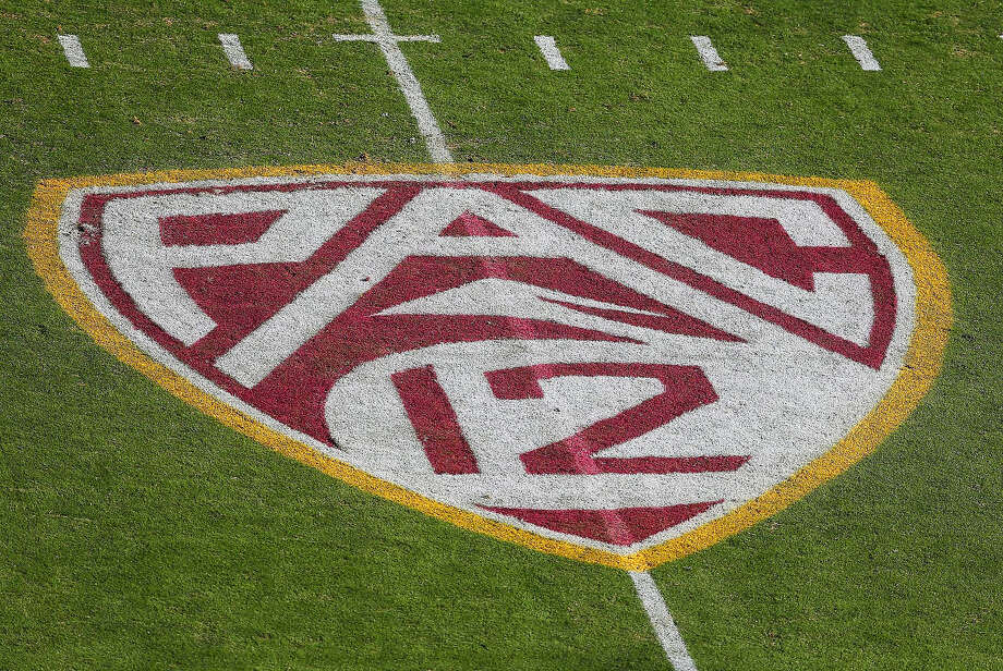 """The """"Pac 12"""" logo is displayed on the filed during a football game between visiting Washington and Arizona State at Sun Devil Stadium in Tempe, Arizona, on October 19, 2013. (Christian Petersen/Getty Images/TNS) Photo: Christian Petersen / Getty Images 2013"""
