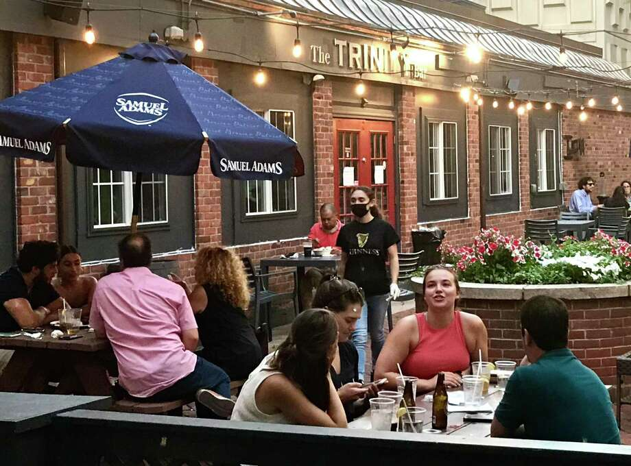 Outside on the patio at the Trinity Bar Friday night. Photo: Dan Haar / Hearst Connecticut Media