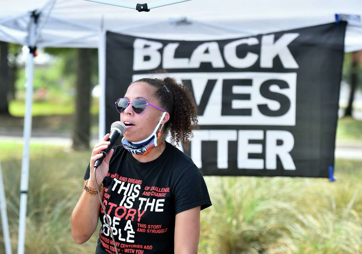 Ananda Tomas speaks during a Black Lives Matter National Day of Action car caravan and food drive that began at the ATT Center and traversed along Commerce Street to Monterey Park on the west side.