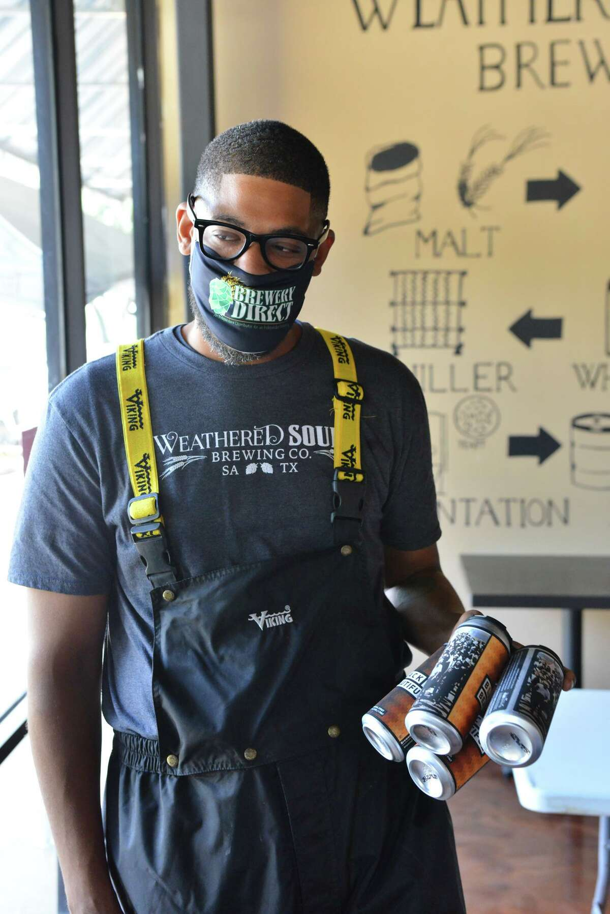 Marcus Baskerville of Weathered Souls Brewery talks after he and the brewery presented 100 Black Men with a check for $20,000 Friday afternoon.