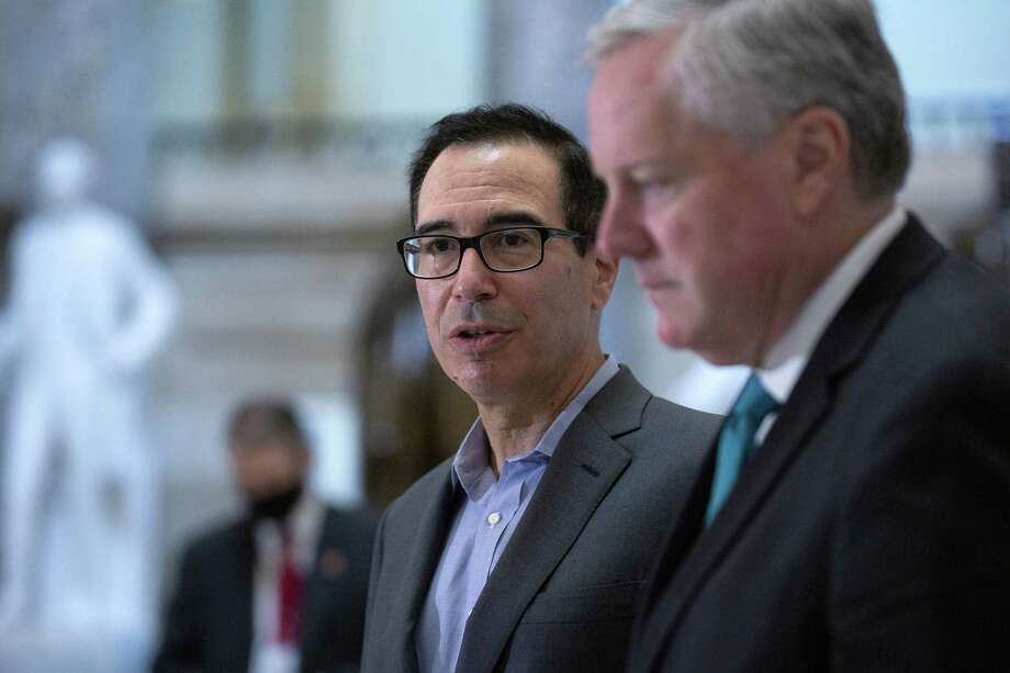 Mark Meadows, White House chief of staff, right, listens as Steven Mnuchin, U.S. Treasury secretary, center, speaks to members of the media following a meeting at the U.S. Capitol in Washington, D.C., U.S., on Saturday, Aug. 1, 2020. MeadowsA said Democrats rebuffed multiple proposals from the Trump administration to extend lapsing supplemental unemployment benefits and have continued to raise the ante in talks on a stimulus package to bolster a U.S. economy hobbled by the coronavirus pandemic. Photographer: Stefani Reynolds/Bloomberg Photo: Stefani Reynolds / © 2020 Bloomberg Finance LP
