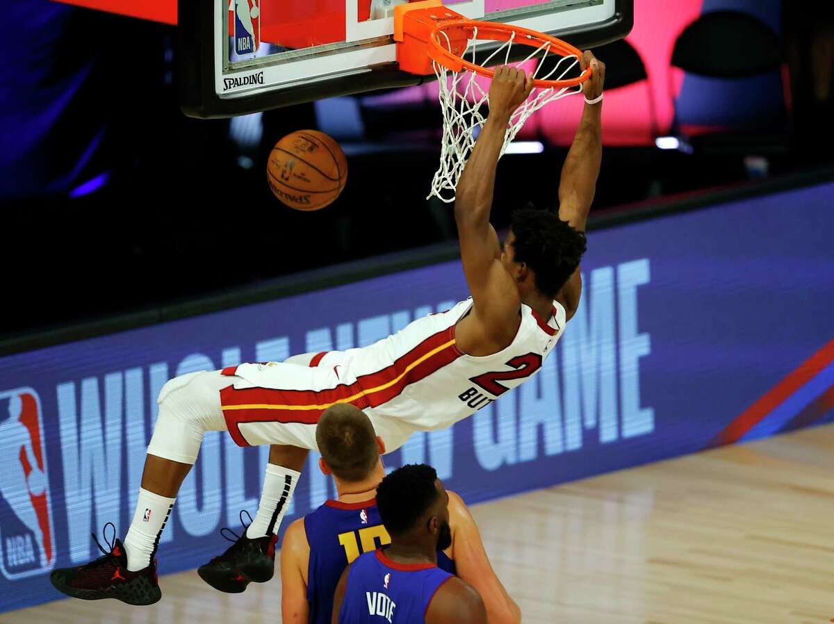 LAKE BUENA VISTA, FLORIDA - AUGUST 01: Jimmy Butler #22 of the Miami Heat dunks against the Denver Nuggets at HP Field House at ESPN Wide World Of Sports Complex on August 01, 2020 in Lake Buena Vista, Florida. NOTE TO USER: User expressly acknowledges and agrees that, by downloading and or using this photograph, User is consenting to the terms and conditions of the Getty Images License Agreement. (Photo by Kevin C. Cox/Getty Images)