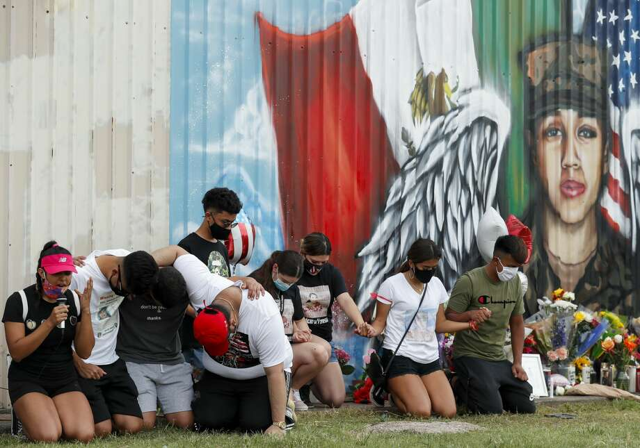 Friends and classmates of Army Pfc. Vanessa Guillén, kneel in prayer in front of a mural in her memory on July 5, in Houston. Guillén, 20, was presumably killed by a fellow soldier after she went missing in April. Photo: Godofredo A. Vásquez/Staff Photographer / ? 2020 Houston Chronicle