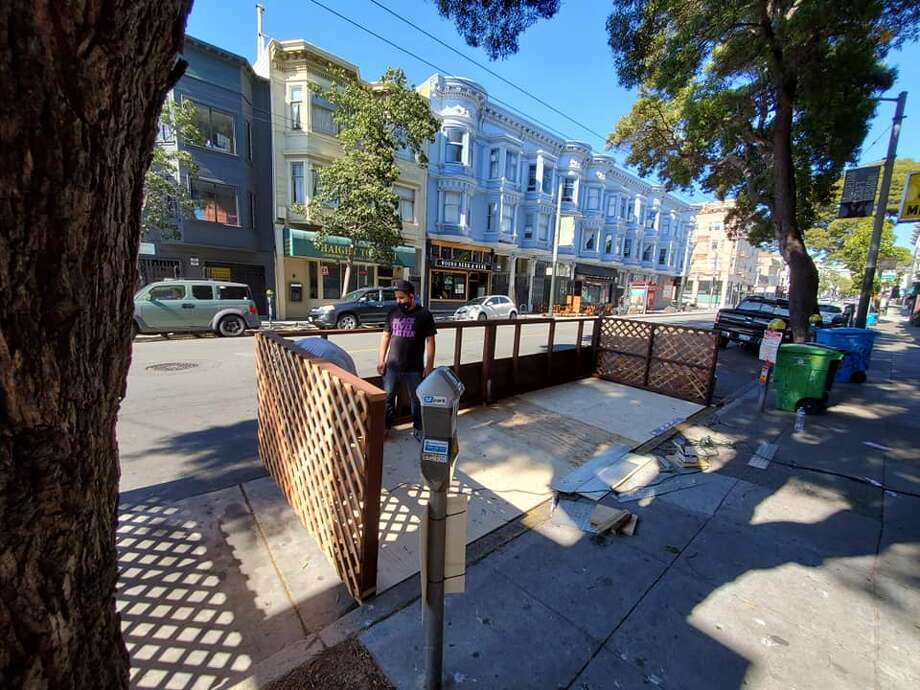 One of two parklets is seen in progress in front of Toronado and neighboring Berliner Berliner, as the two businesses prepare to welcome back customers at its outdoor seating area. Photo: Eric Vanderlin