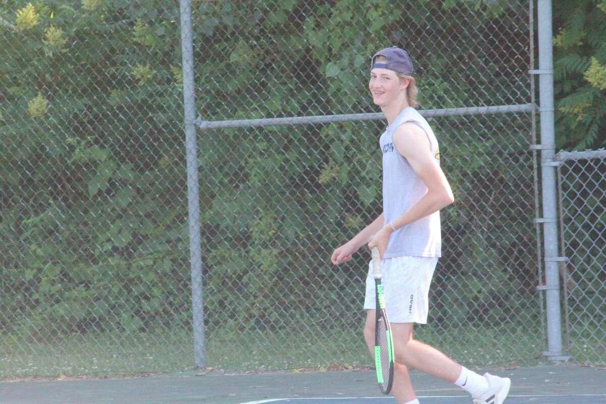 Spencer Olen works on his game during a Big Rapids tennis summer practice. (Pioneer photo/John Raffel)