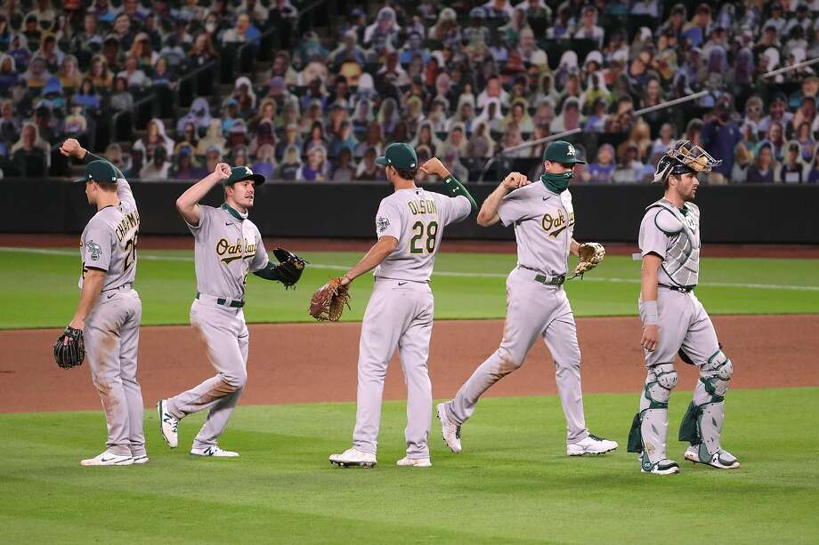 The A's celebrate their 3-2 win over the Mariners at T-Mobile Park in Seattle, which snapped a three-game losing streak. Photo: Abbie Parr / Getty Images