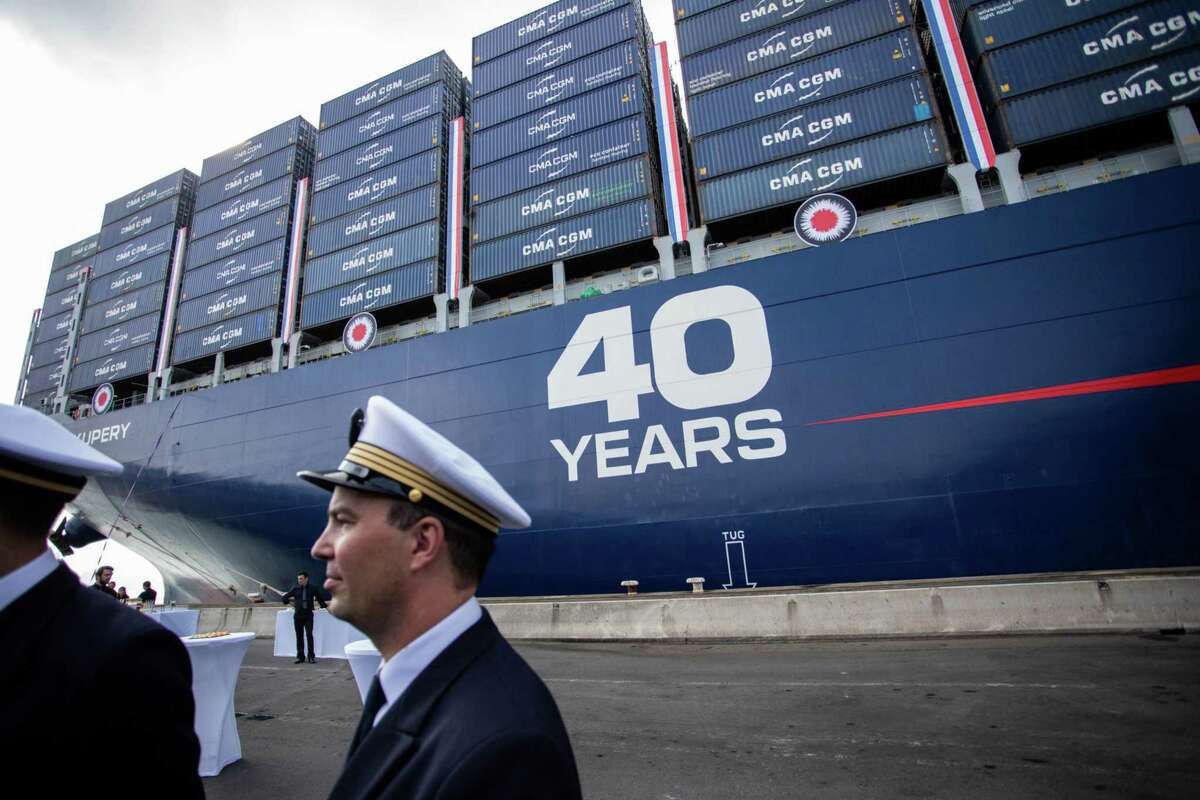 Crew members stand on the dock as the container ship Antoine de Saint Exupery sits moored ahead of its official inauguration at the Port of Le Havre in Le Havre, France, on Sept. 6, 2018.