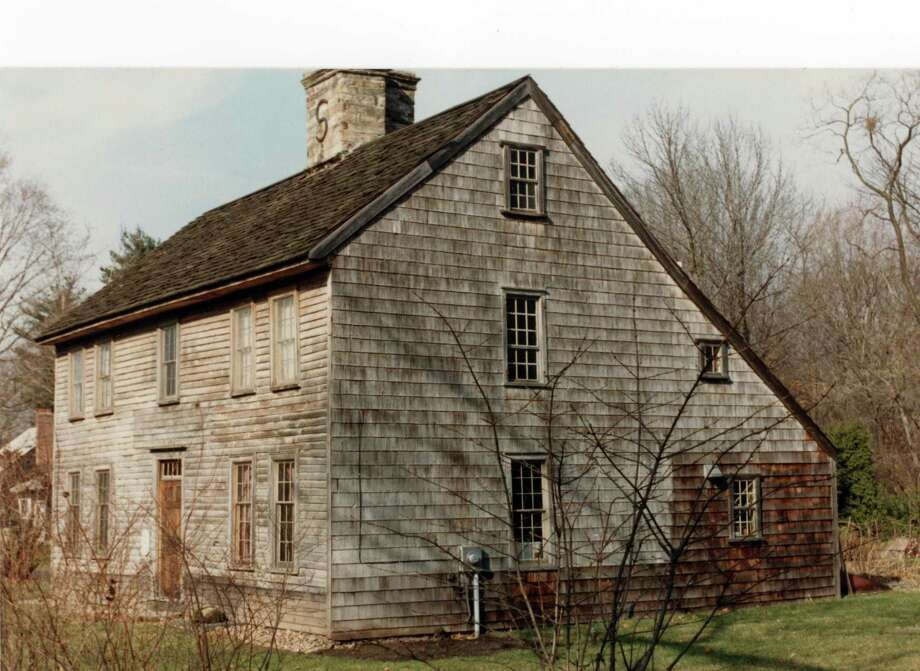 "The Pond Weed House, also known as ""The House Under the Hill,"" is one of the town's oldest homes. This 1970s photo accompanies its listing on the National Register of Historic Places. Photo: Museum Of Darien Archives / Connecticut Post"