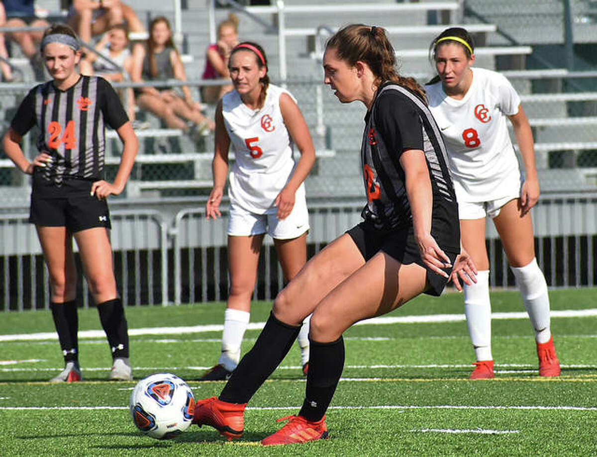 Edwardsville's Macie Hockett buries a PK goal in the 79th minute to put EHS ahead 2-0 in the regional championship game.