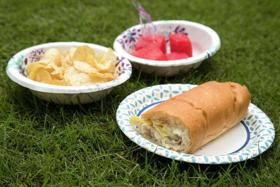 While picnicking during a pandemic, do not bring food that is meant to be shared. Opt for individually packaged sandwiches, salads or snacks. Instead of putting a bag of chips out, portion them out into personal sandwich bags or individual plates. Photo: Brett Coomer / Staff Photographer / © 2020 Houston Chronicle