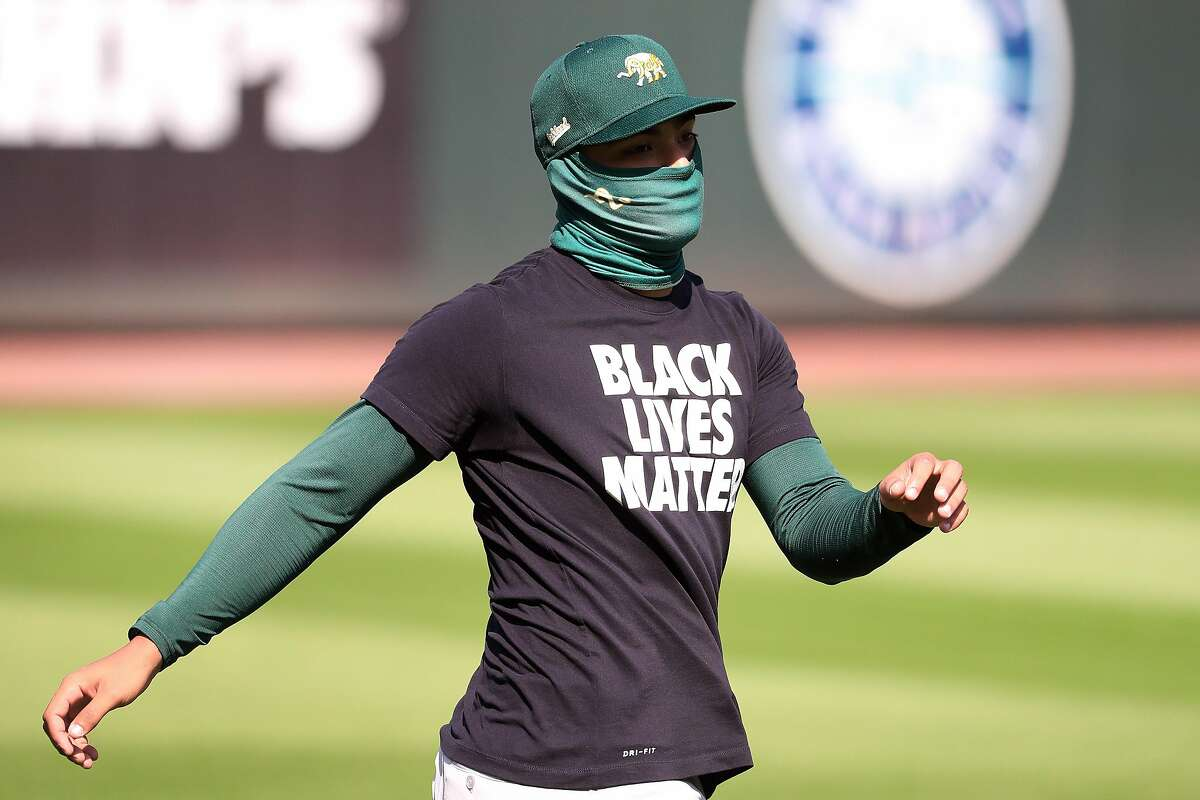 Jesus Luzardo of the Oakland Athletics warms up wearing a Black Lives Matter T-Shirt prior to their Opening Day game against the Seattle Mariners at T-Mobile Park on July 31, 2020 in Seattle, Washington. (Photo by Abbie Parr/Getty Images)