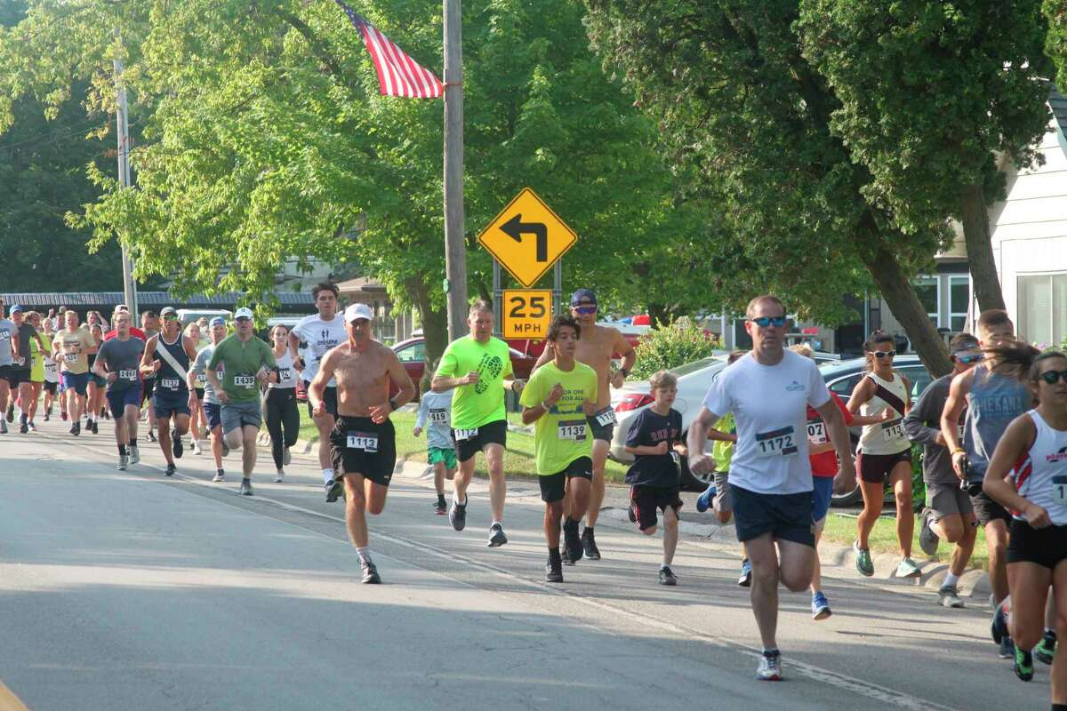 File - People participate in Onekama Days annual 5K run.