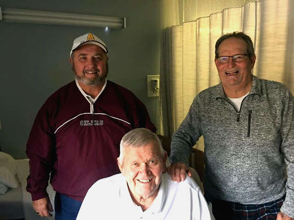 Former longtime football coach Wayne Williams, center, is visited by former EA-WR players Phil Keasler, left, and Bob Kulp.Williams died Friday at age 85.