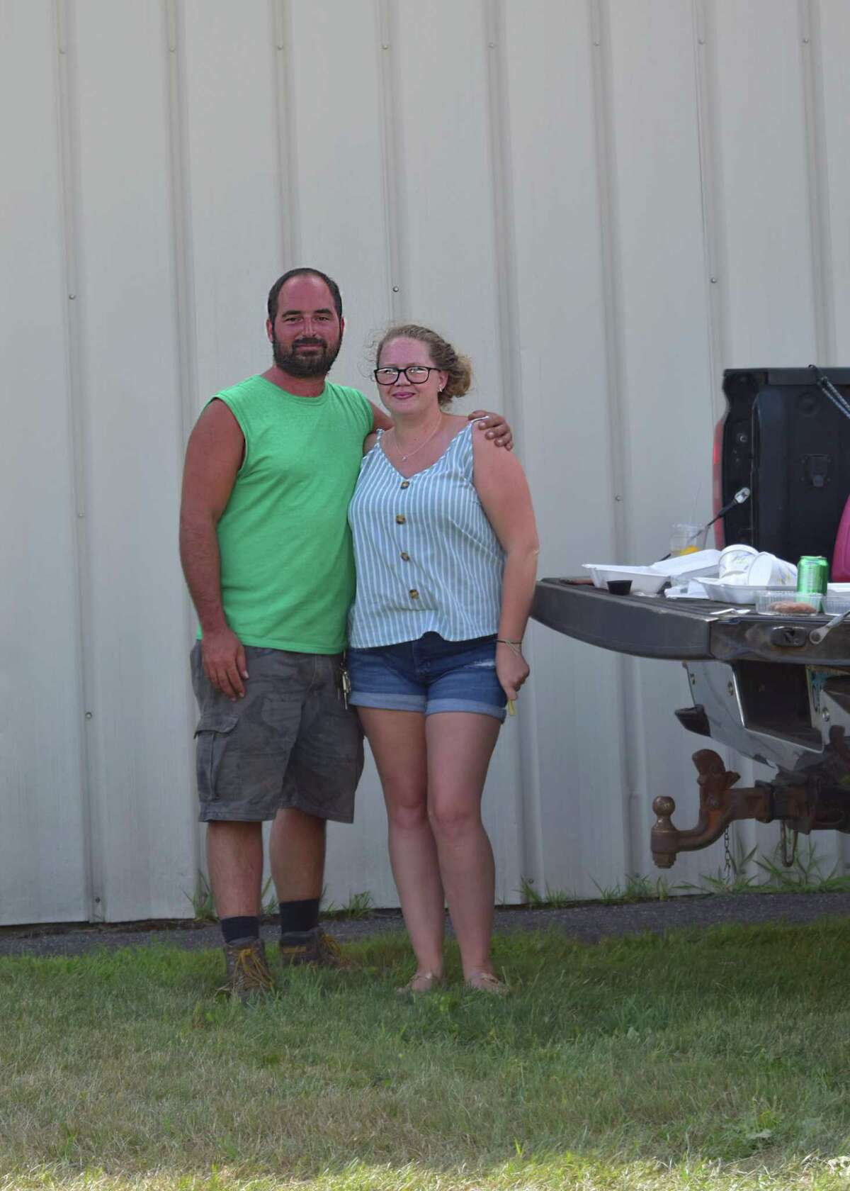 Eric Vogt and Britney Correll of Burlington enjoyed Low N Slow Mac N Cheese while tailgating Aug. 1 at the Food Truck Drive-Thru Festival at the Goshen Fairgrounds.