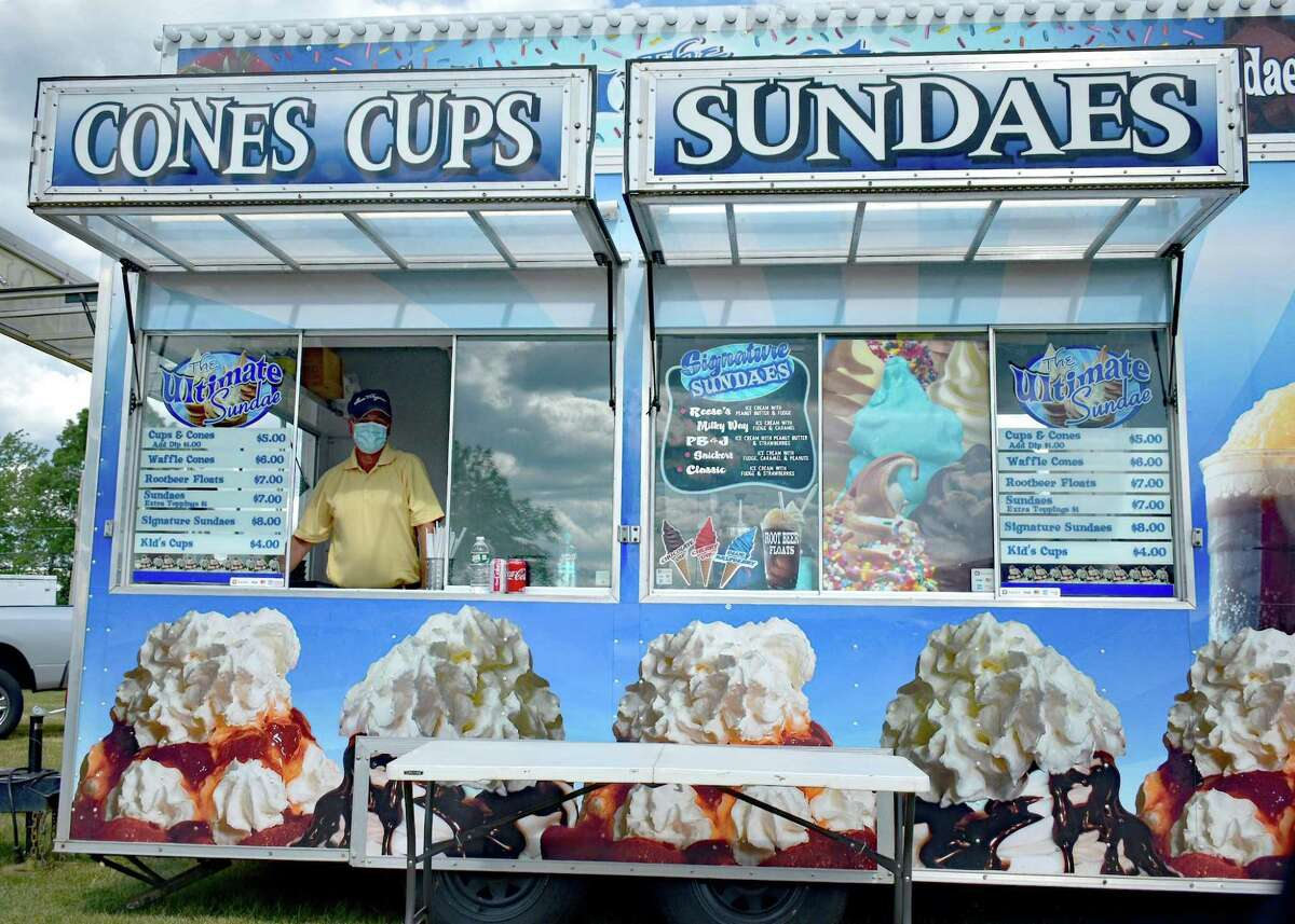 A staffer at Cones Cups and Sandaes waits to fill an order at the food truck festival in Goshen, held Aug. 1.