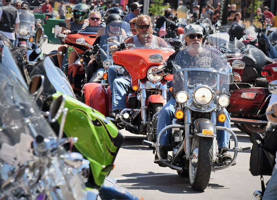 This Aug. 2, 2019 photo shows Heavy traffic   on legendary Main Street in Sturgis, S.D., South Dakota, which has seen an uptick in coronavirus infections in recent weeks, is bracing to host hundreds of thousands of bikers for the 80th edition of the Sturgis Motorcycle Rally. More than 250,000 people are expected to attend the Aug. 7 to Aug. 16 rally in western South Dakota.  (Jim Holland/Rapid City Journal via AP) Photo: Jim Holland, Associated Press