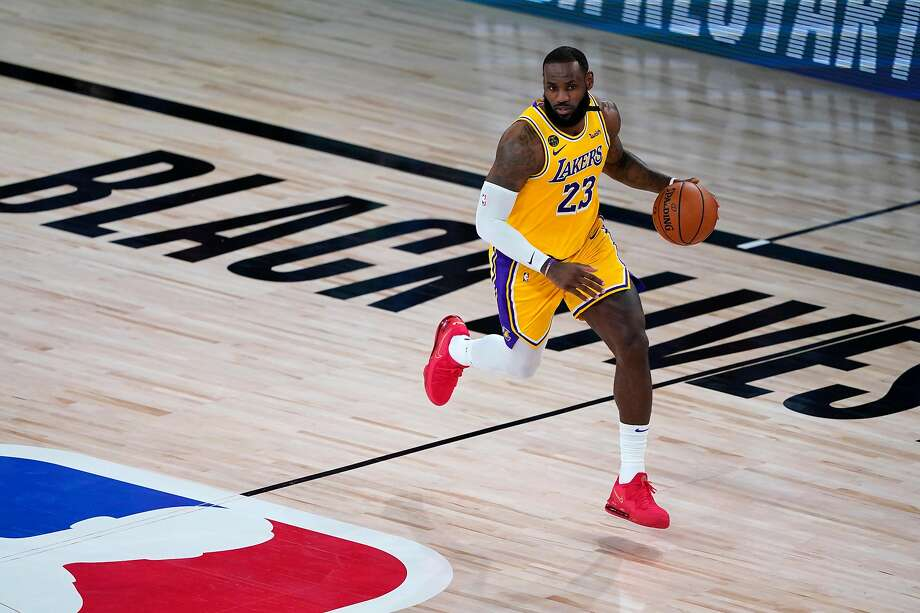 LeBron James of the Los Angeles Lakers controls the ball during the first half of an NBA basketball game against the Toronto Raptors at The Arena in the ESPN Wide World Of Sports Complex on August 1, 2020 in Lake Buena Vista, Florida. Photo: Pool / Getty Images